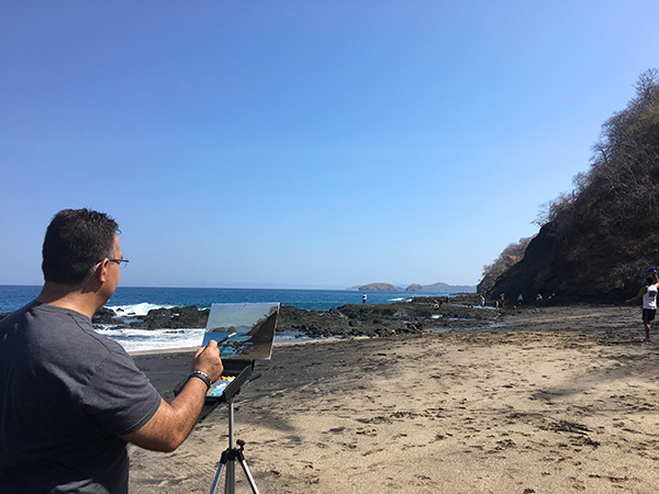 Santiago Perez painting on Ocotal Beach in Guanacaste Costa Rica